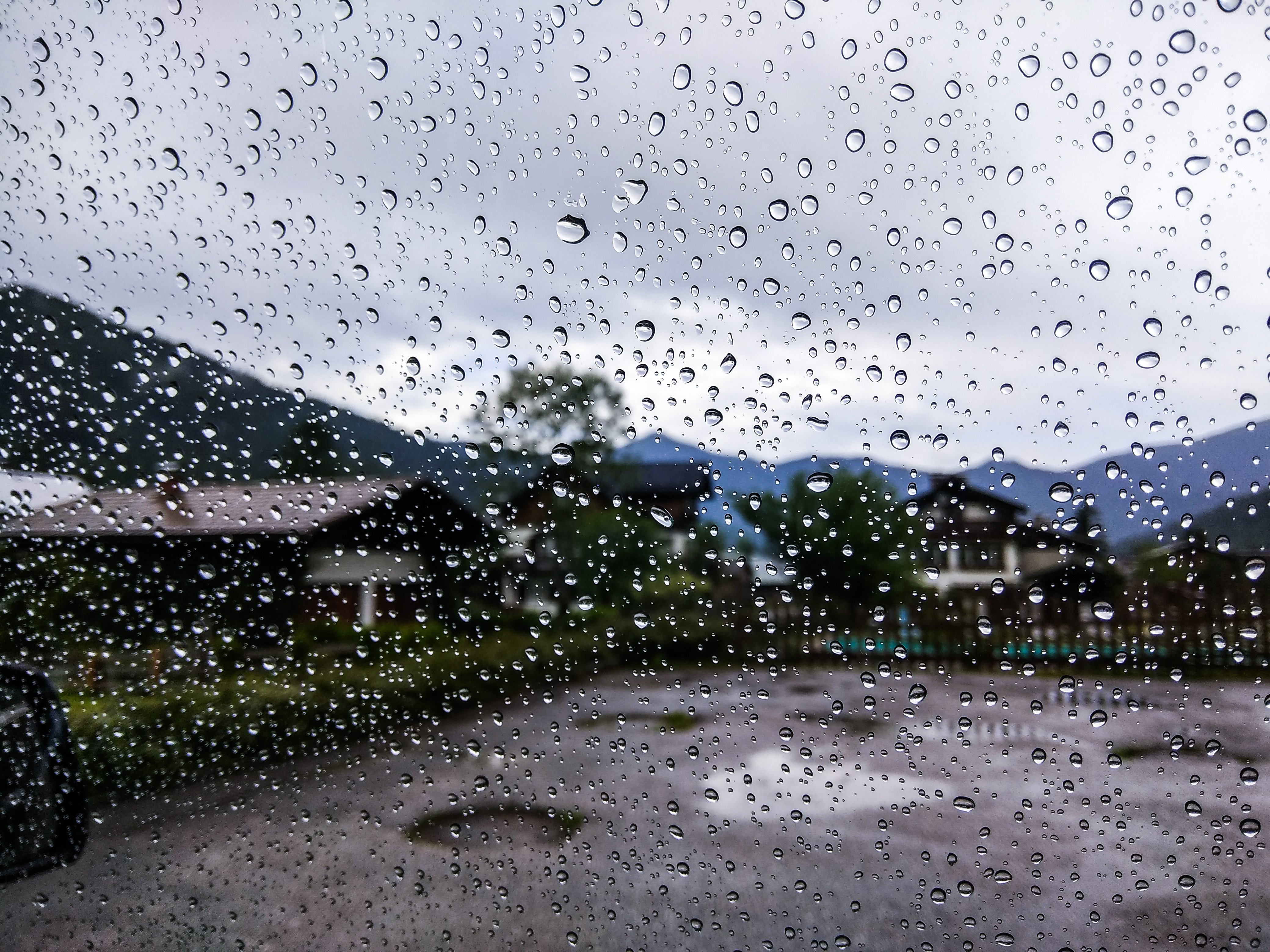 Rain drops at the front glass of our rented car in Austria was also a great photography subject : TravelAnubhav (Travel Anubhav)