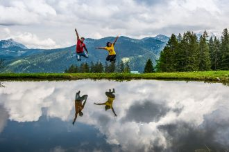 Travel couple photography in Gosau in the austrian alps in Austria by TravelAnubhav