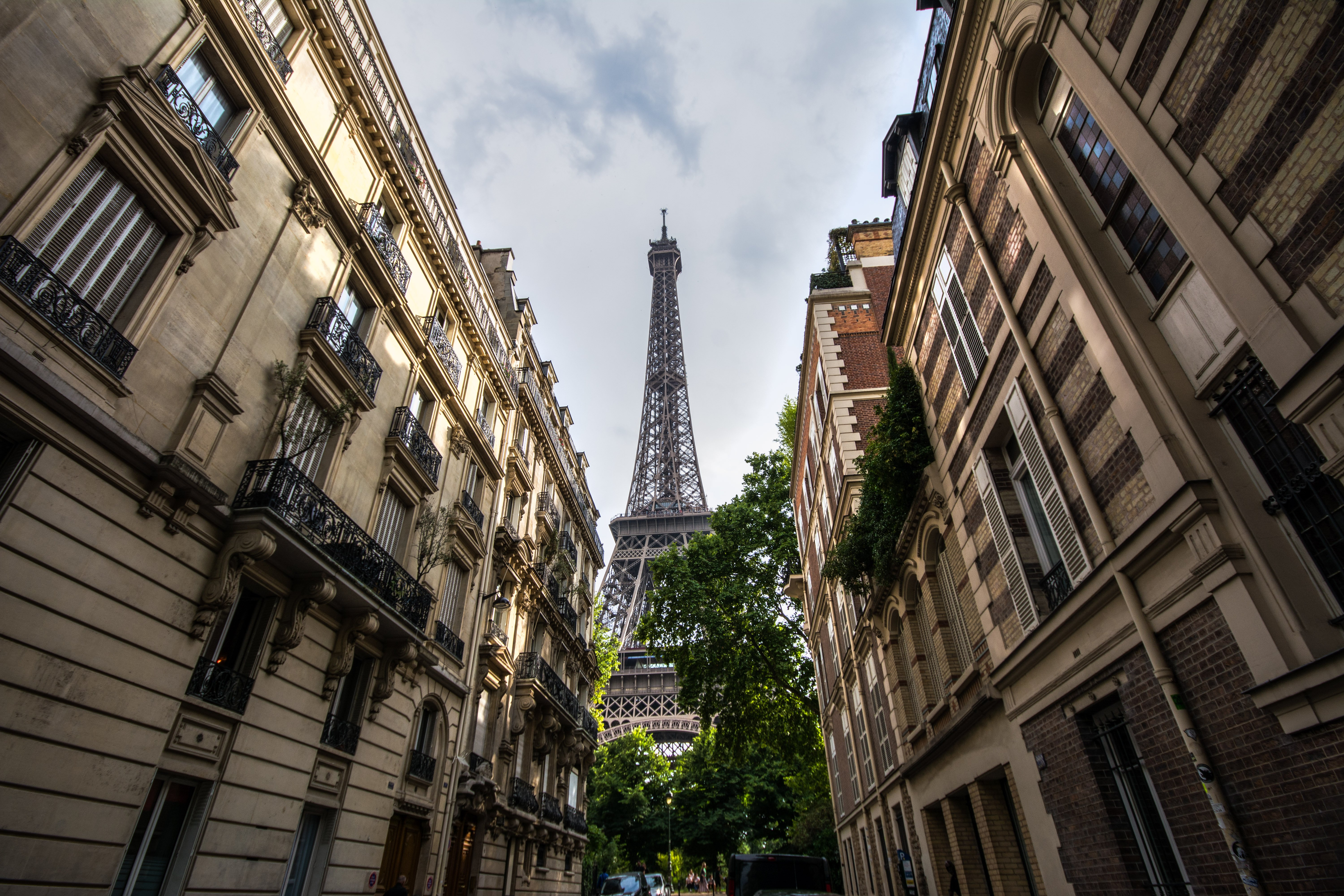 Eiffel tower view from a street of Rue de l'Universite by Travel Anubhav