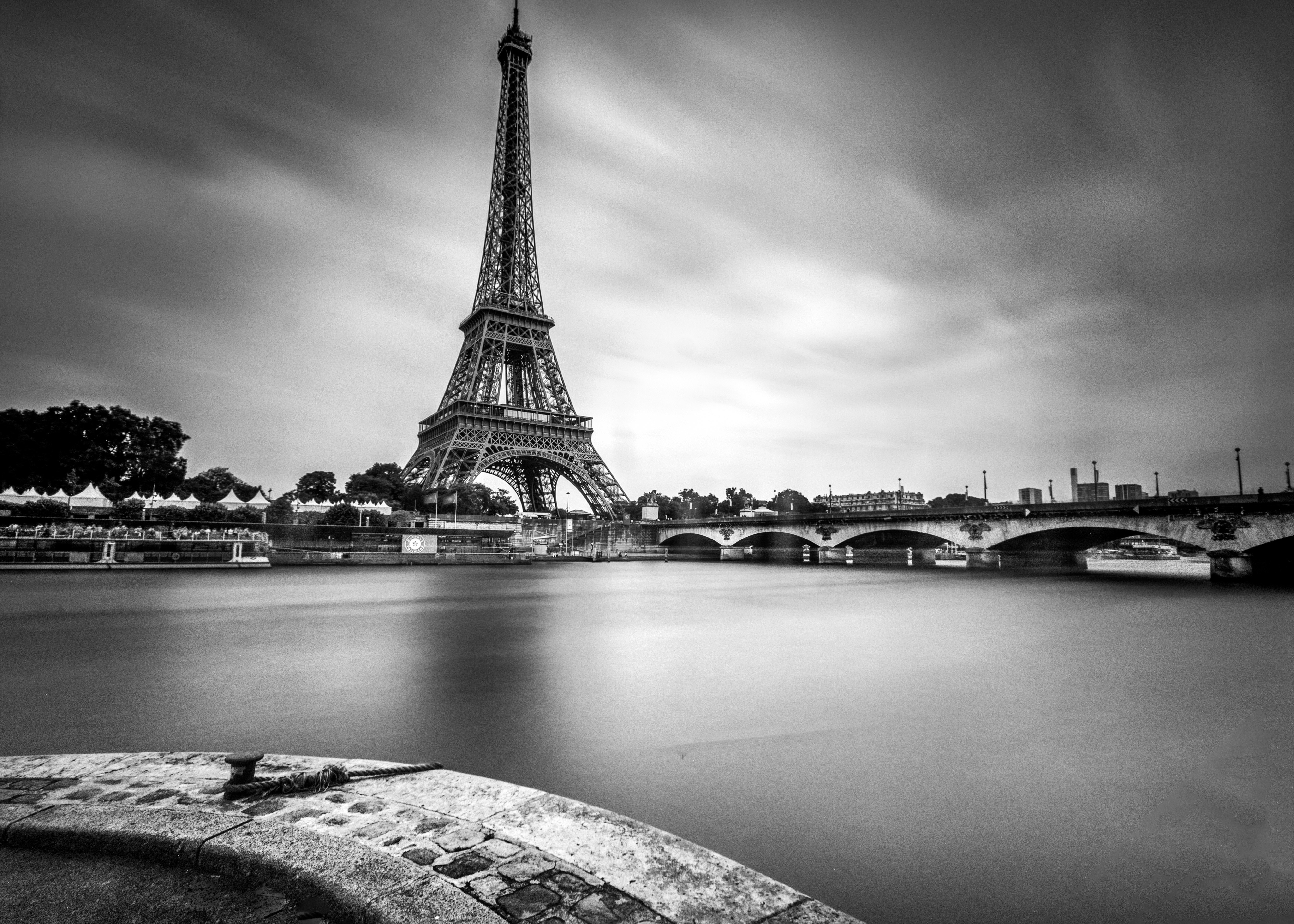 Walk along Seine River with cloud trails as long shutter photography paris by Travel Anubhav