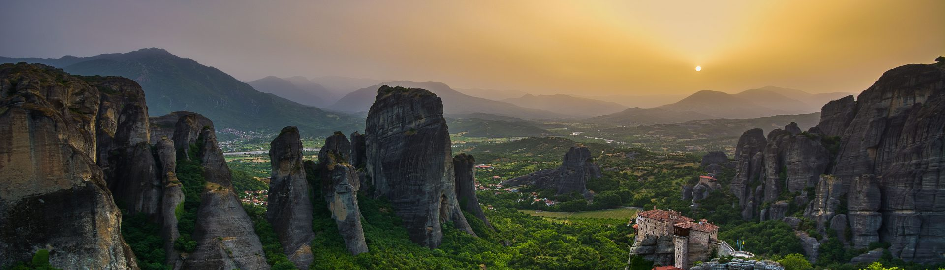Panoramic view of Meteora with amazing sunset.